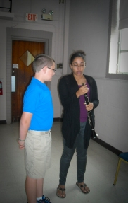 Cultural Development Coordinator, Keirsten Johnson, walks student through the basics of clarinet playing.
