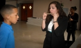 Director of Community Outreach, Fofi Panagiotouros, demonstrates how to start playing the flute.