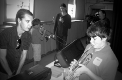 Production Manager, John Macdonald, helps students explore trumpet playing.